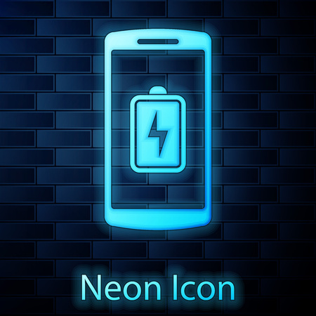 Glowing neon Smartphone battery charge icon isolated on brick wall background. Phone with a low battery charge. Vector Illustration  イラスト・ベクター素材