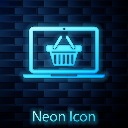 Glowing neon Shopping basket on screen laptop icon isolated on brick wall background. Concept e-commerce, e-business, online business marketing. Vector Illustration