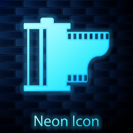 Glowing neon Camera vintage film roll cartridge icon isolated on brick wall background. Film reel icon. 35mm film canister. Filmstrip photographer equipment. Vector Illustration