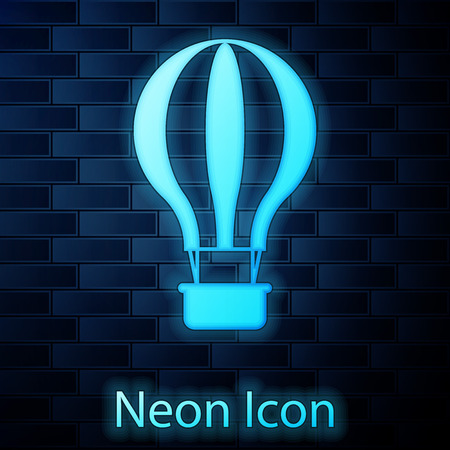 Glowing neon Hot air balloon icon isolated on brick wall background. Air transport for travel. Vector Illustration