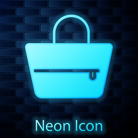 Glowing neon Handbag icon isolated on brick wall background. Female handbag sign. Glamour casual baggage symbol. Vector Illustration