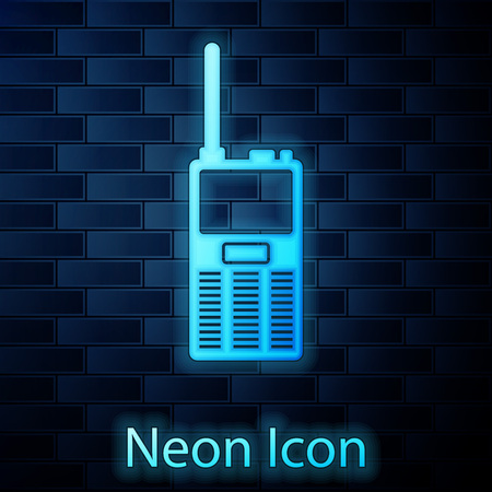 Glowing neon Walkie talkie icon isolated on brick wall background. Portable radio transmitter icon. Radio transceiver sign. Vector Illustration