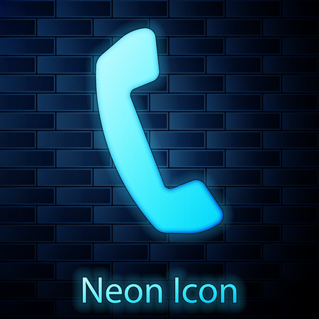 Glowing neon Telephone handset icon isolated on brick wall background. Phone sign. Vector Illustration