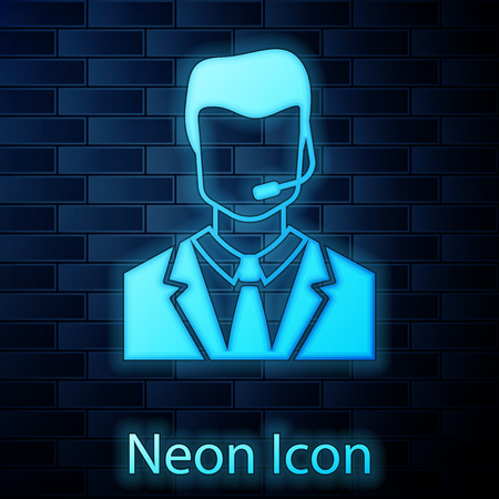 Glowing neon Man with a headset icon isolated on brick wall background. Support operator in touch. Concept for call center, client support service. Vector Illustration Foto de archivo - 124802997