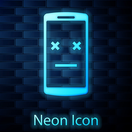 Glowing neon Dead phone icon isolated on brick wall background. Deceased digital device emoji symbol. Corpse smartphone showing facial emotion. Vector Illustration