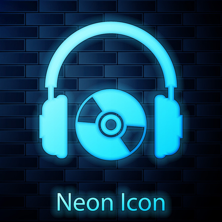 Glowing neon Headphones and CD or DVD icon isolated on brick wall background. Earphone sign. Compact disk symbol. Vector Illustration