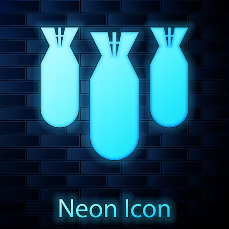Glowing neon Aviation bombs icon isolated on brick wall background. Rocket bomb flies down. Vector Illustration