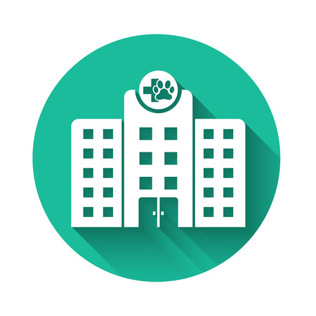 White Veterinary medicine hospital, clinic or pet shop for animals icon isolated with long shadow. Vet or veterinarian clinic. Green circle button. Vector Illustration