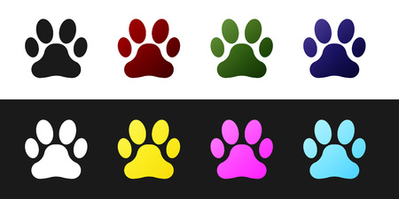 Set Paw print icon isolated on black and white background. Dog or cat paw print. Animal track. Vector Illustration