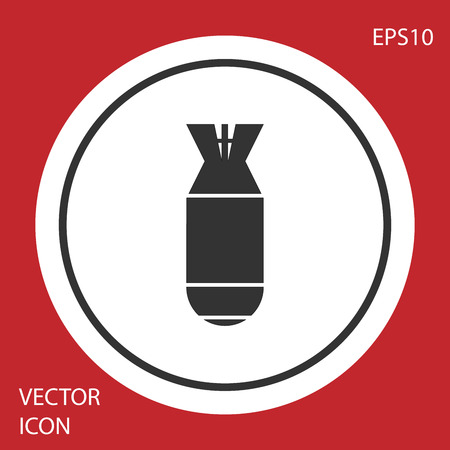 Grey Aviation bomb icon isolated on red background. Rocket bomb flies down. White circle button. Vector Illustration