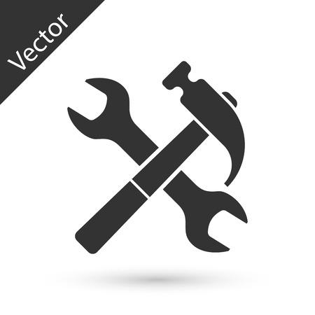 Szara skrzyżowana ikona młotka i klucza na białym tle. Narzędzia sprzętowe. Ilustracja wektorowa