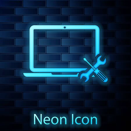 Glowing neon Laptop with screwdriver and wrench icon isolated on brick wall background. Adjusting, service, setting, maintenance, repair, fixing. Vector Illustration