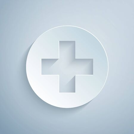 Paper cut Medical cross in circle icon isolated on grey background. First aid medical symbol. Paper art style. Vector Illustration
