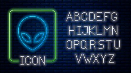 Glowing neon Alien icon isolated on brick wall background. Extraterrestrial alien face or head symbol. Neon light alphabet. Vector Illustration