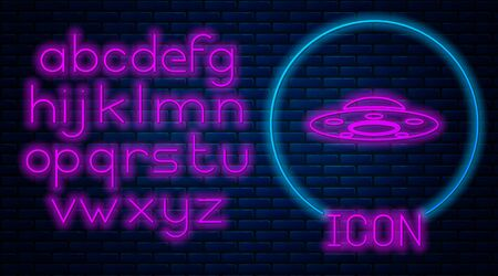 Glowing neon UFO flying spaceship icon isolated on brick wall background. Flying saucer. Alien space ship. Futuristic unknown flying object. Neon light alphabet. Vector Illustration