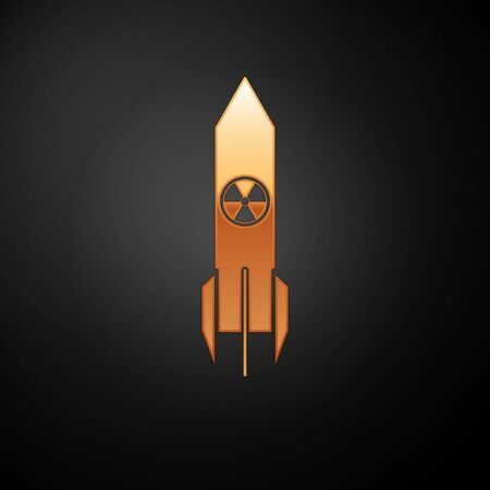 Gold Nuclear rocket icon isolated on black background. Rocket bomb flies down. Vector Illustration  イラスト・ベクター素材