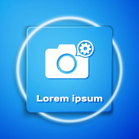 White Photo camera and gear icon isolated on blue background. Adjusting app, service concept, setting options, maintenance, repair, fixing. Blue square button. Vector Illustration