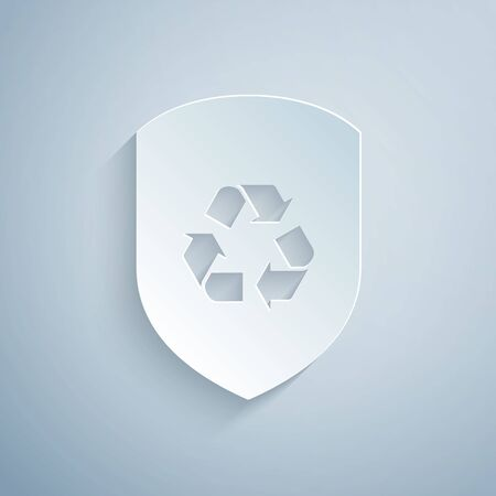 Paper cut Recycle symbol inside shield icon isolated on grey background. Eco protection sign. Paper art style. Vector Illustration