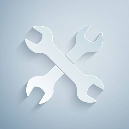Paper cut Crossed wrenchs icon isolated on grey background. Spanner repair tool. Service tool symbol. Paper art style. Vector Illustration  イラスト・ベクター素材