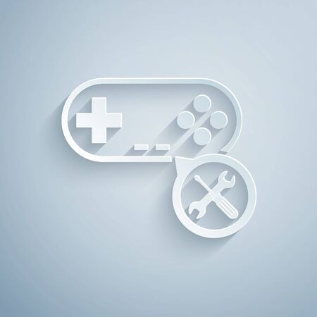 Paper cut Gamepad with screwdriver and wrench icon isolated on grey background. Adjusting, service, setting, maintenance, repair, fixing. Paper art style. Vector Illustration