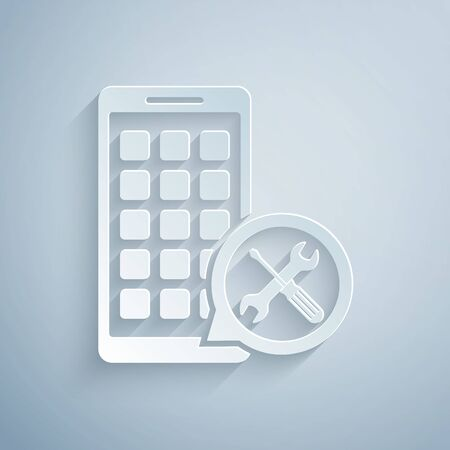 Paper cut Mobile Apps with screwdriver and wrench icon isolated on grey background. Adjusting, service, setting, maintenance, repair, fixing. Paper art style. Vector Illustration