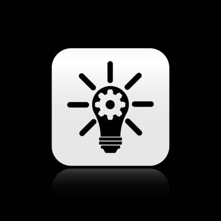 Black Light bulb with rays shine and gear inside icon isolated on black background. Innovation concept. Silver square button. Vector Illustration