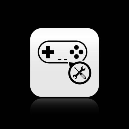 Black Gamepad with screwdriver and wrench icon isolated on black background. Adjusting, service, setting, maintenance, repair, fixing. Silver square button. Vector Illustration