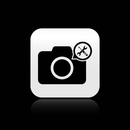 Black Photo camera with screwdriver and wrench icon isolated on black background. Adjusting, service, setting, maintenance, repair, fixing. Silver square button. Vector Illustration