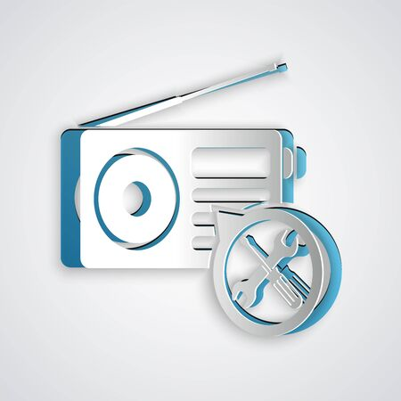 Paper cut Radio with screwdriver and wrench icon isolated on grey background. Adjusting, service, setting, maintenance, repair, fixing. Paper art style. Vector Illustration