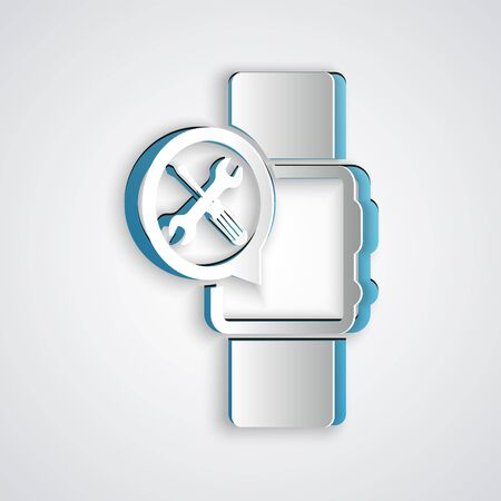 Paper cut Smartwatch with screwdriver and wrench icon isolated on grey background. Adjusting, service, setting, maintenance, repair, fixing. Paper art style. Vector Illustration Banque d'images - 130721109