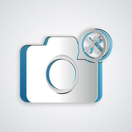 Paper cut Photo camera with screwdriver and wrench icon isolated on grey background. Adjusting, service, setting, maintenance, repair, fixing. Paper art style. Vector Illustration