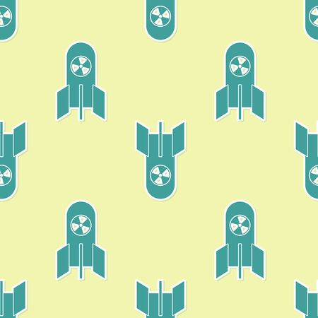 Green Nuclear bomb icon isolated seamless pattern on yellow background. Rocket bomb flies down. Vector Illustration Stock Illustratie