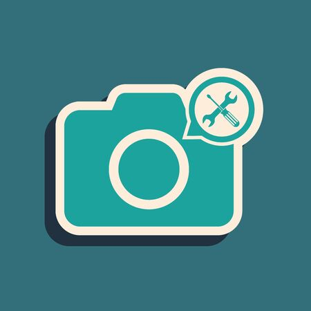 Green Photo camera with screwdriver and wrench icon isolated on blue background. Adjusting, service, setting, maintenance, repair, fixing. Long shadow style. Vector Illustration