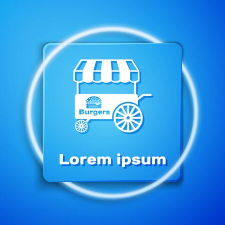 White Fast street food cart with awning icon isolated on blue background. Burger or hamburger icon. Urban kiosk. Blue square button. Vector Illustration