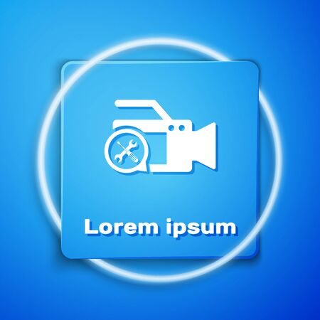 White Video camera with screwdriver and wrench icon isolated on blue background. Adjusting, service, setting, maintenance, repair, fixing. Blue square button. Vector Illustration  イラスト・ベクター素材