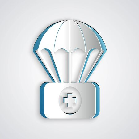 Paper cut Parachute with first aid kit icon isolated on grey background. Medical insurance. Paper art style. Vector Illustration Standard-Bild - 131471744