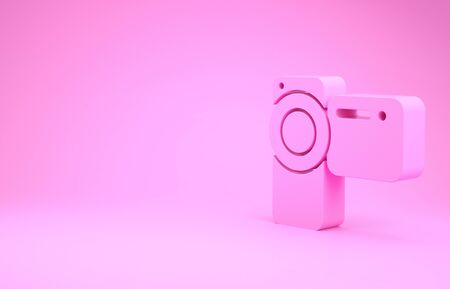 Pink Cinema camera icon isolated on pink background. Video camera. Movie sign. Film projector. Minimalism concept. 스톡 콘텐츠