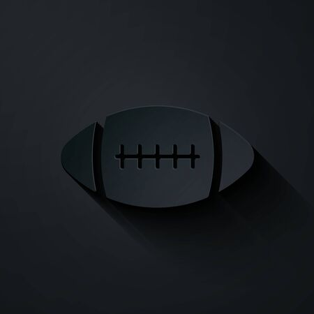 Paper cut American Football ball icon isolated on black background. Paper art style. Vector Illustration