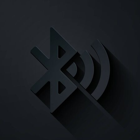 Paper cut Bluetooth connected icon isolated on black background. Paper art style. Vector Illustration