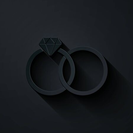 Paper cut Wedding rings icon isolated on black background. Bride and groom jewelery sign. Marriage icon. Diamond ring. Paper art style. Vector Illustration Ilustração