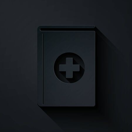 Paper cut Medical book icon isolated on black background. Paper art style. Vector Illustration