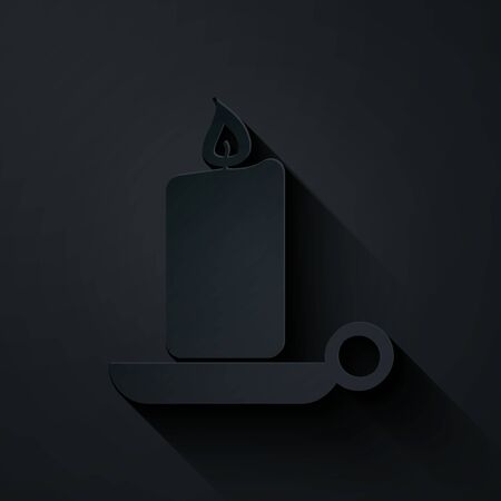 Paper cut Burning candle in candlestick icon isolated on black background. Old fashioned lit candle. Cylindrical candle stick with burning flame. Paper art style. Vector Illustration Illusztráció