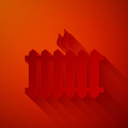Paper cut Heating radiator icon isolated on red background. Paper art style. Vector Illustration