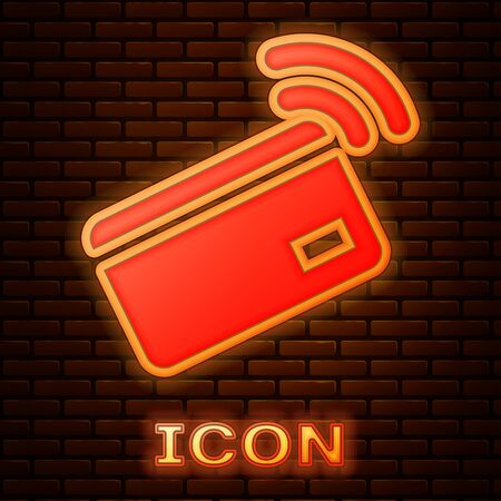 Glowing neon Contactless payment with nfc card icon isolated on brick wall background. Card with radio wave sign. Credit card payment. Vector Illustration