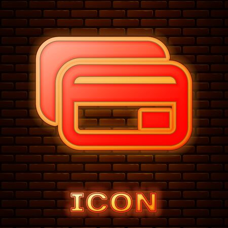 Glowing neon Credit card icon isolated on brick wall background. Online payment. Cash withdrawal. Financial operations. Shopping sign. Vector Illustration
