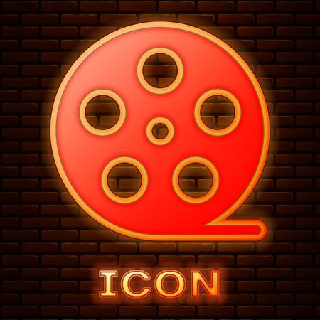 Glowing neon Film reel icon isolated on brick wall background. Vector Illustration