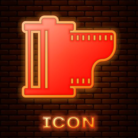 Glowing neon Camera vintage film roll cartridge icon isolated on brick wall background. Film reel. 35mm film canister. Filmstrip photographer equipment. Vector Illustration Illustration