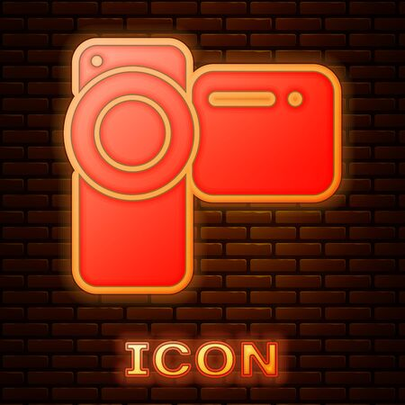 Glowing neon Cinema camera icon isolated on brick wall background. Video camera. Movie sign. Film projector. Vector Illustration Illustration