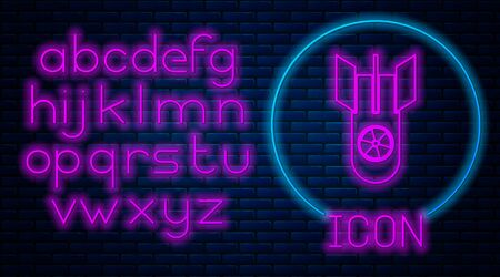 Glowing neon Nuclear bomb icon isolated on brick wall background. Rocket bomb flies down. Neon light alphabet. Vector Illustration