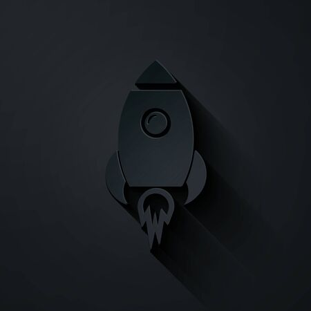 Paper cut Rocket ship with fire icon isolated on black background. Space travel. Paper art style. Vector Illustration